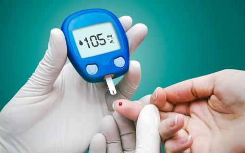 Doctor making blood sugar test.